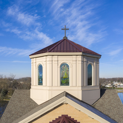 Aerial drone shot of the St. Francis Chapel cupola on a nice sunny day