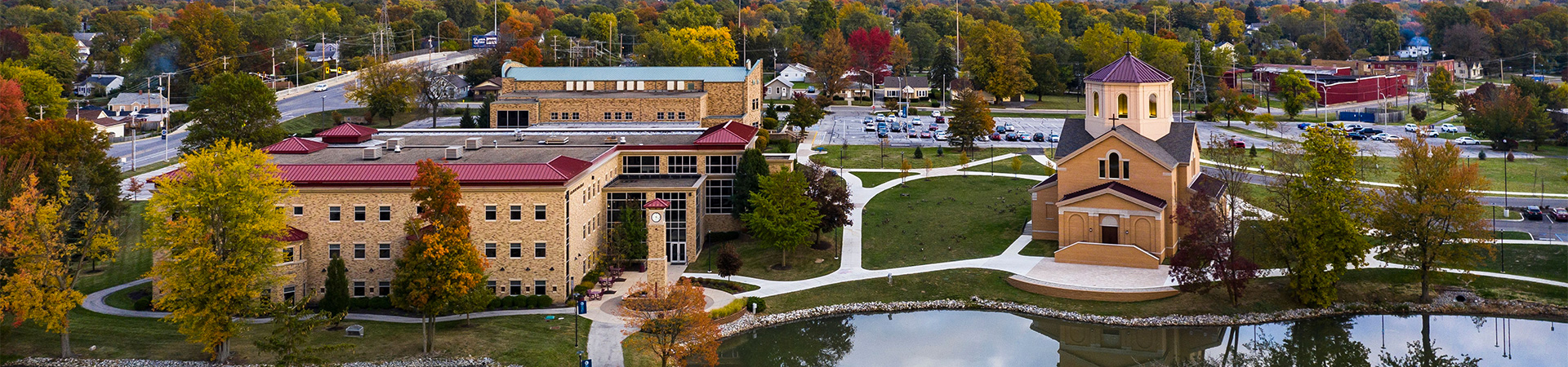 Aerial photo of the Pope John Paul II Center and the St. Francis Chapel taken at sunset on a warm fall day